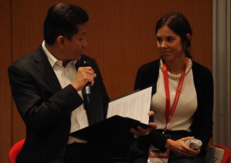 Eddie Razak with Joana Cruz Ferreira Social Investment Lab Portugal at Innovating Malaysia Conference